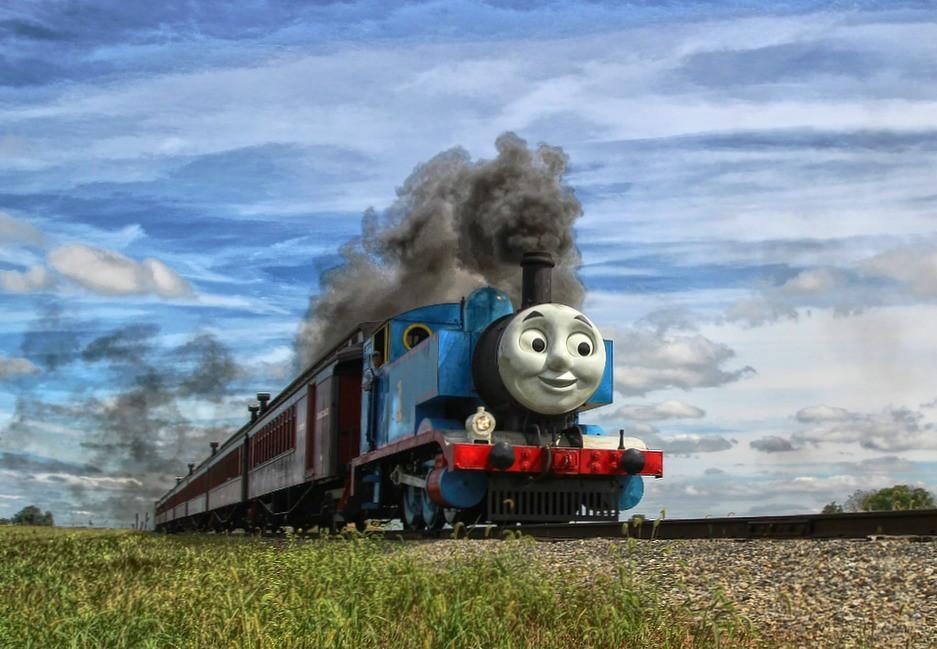 A toy Thomas train on a steel track. Image taken by Forsaken Fotos.