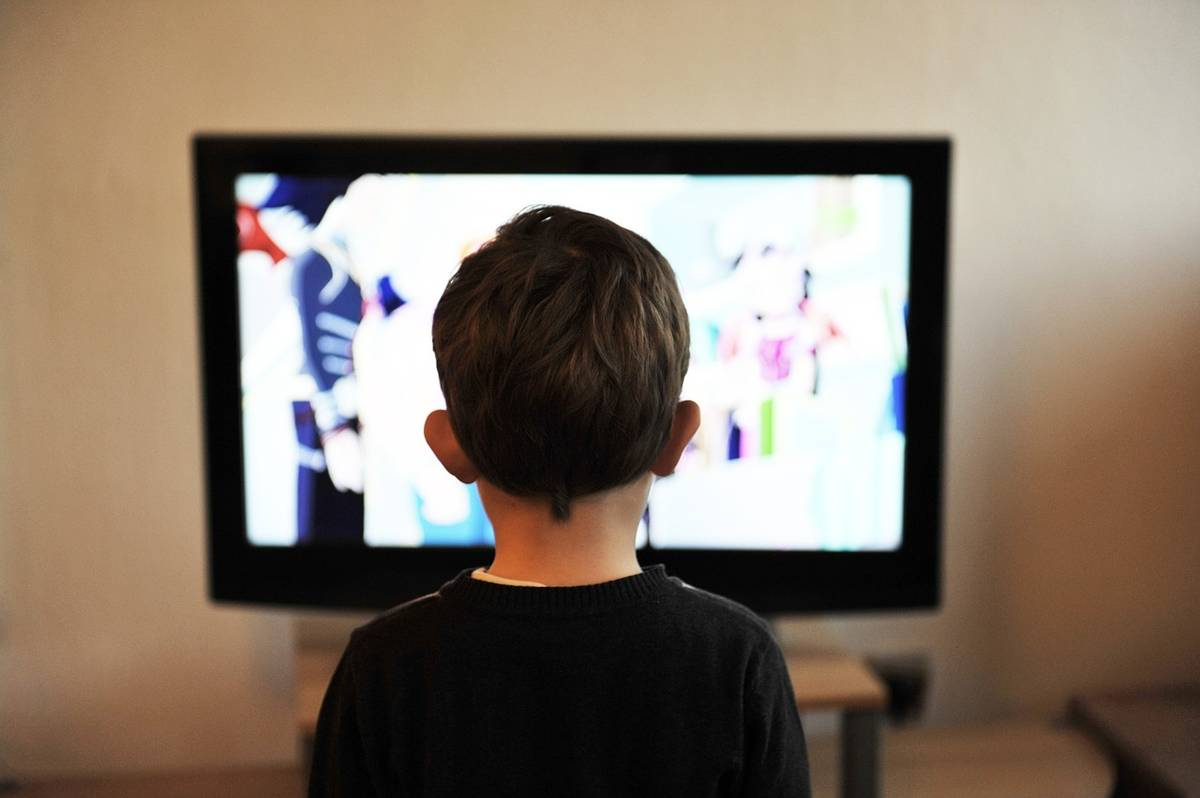 Photo of child watching television