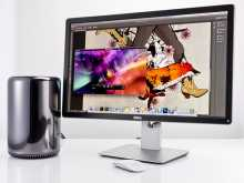 Mac Pro computer monitor an mose on a table