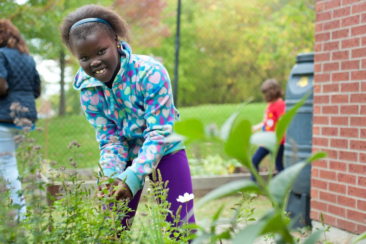 Photo of child gardening