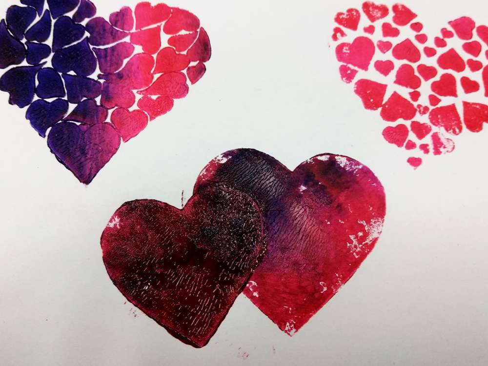 hearts stamped with pink and purple paint