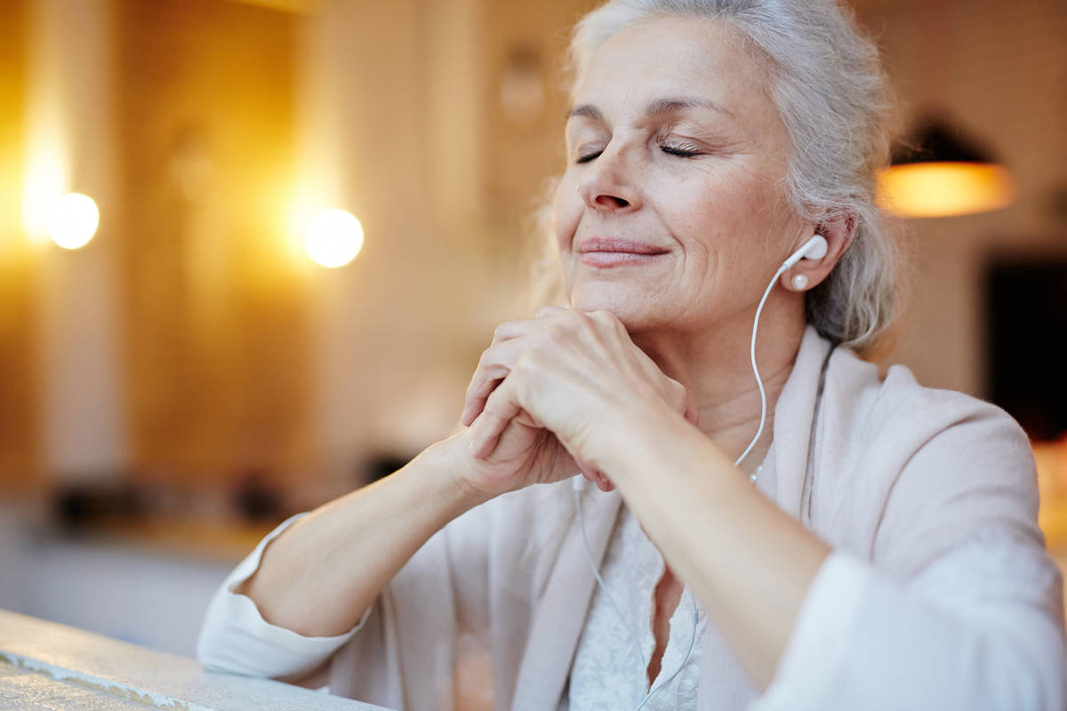 Older Woman Listening with Earbuds