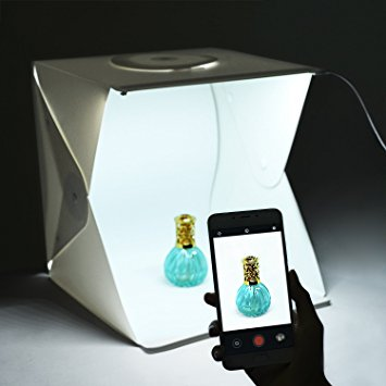 Person taking photo with phone in front of a pop up lightbox