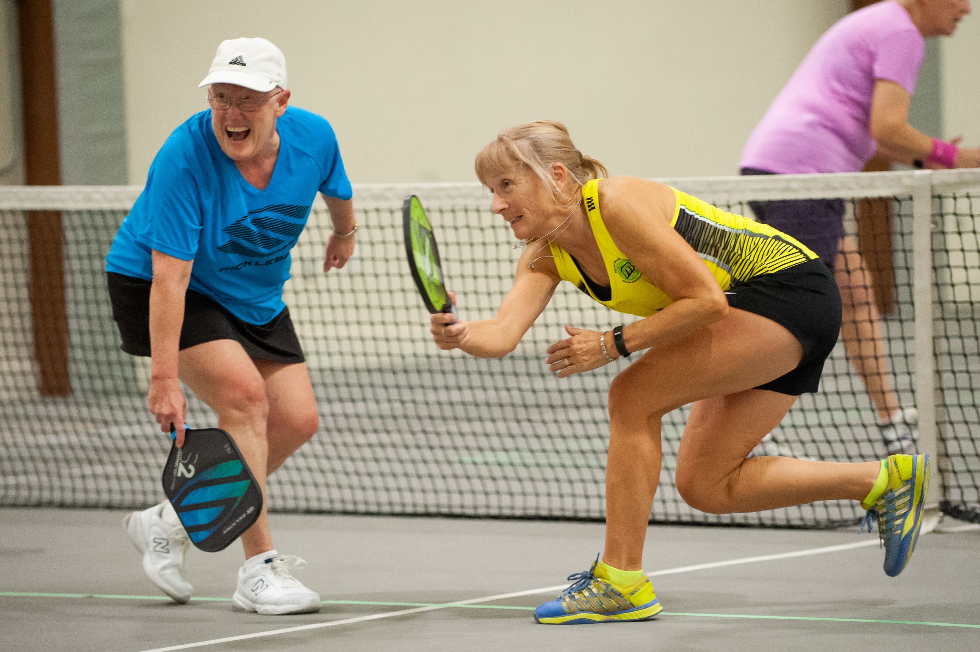 Photo of two women playing Pickleball.