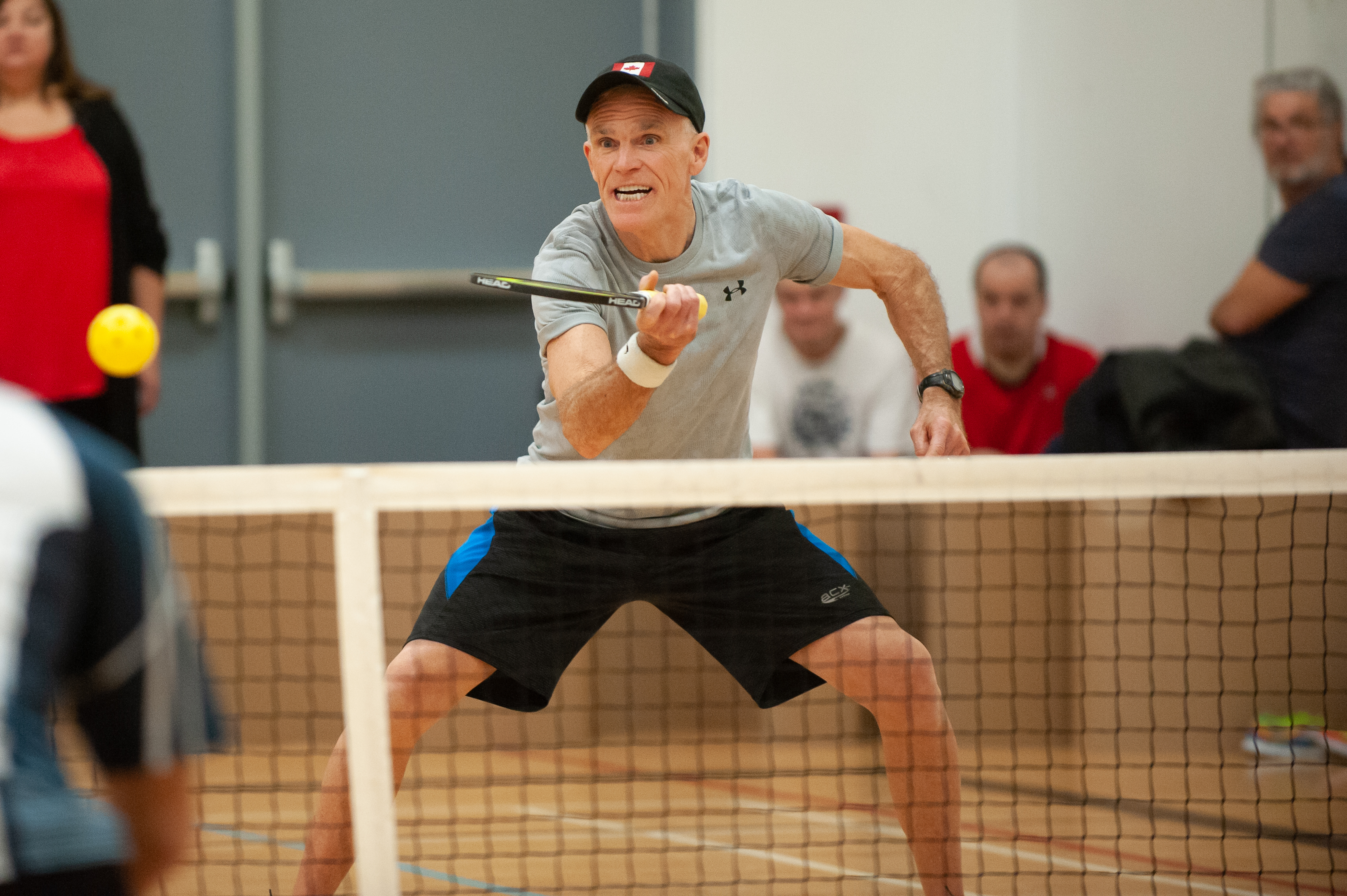 Photo of a man playing Pickleball.