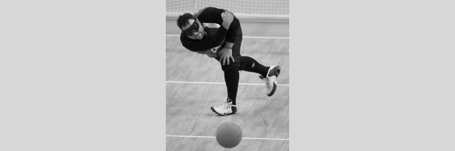 Rob Christy throwing ball, Paralympics, Beijing