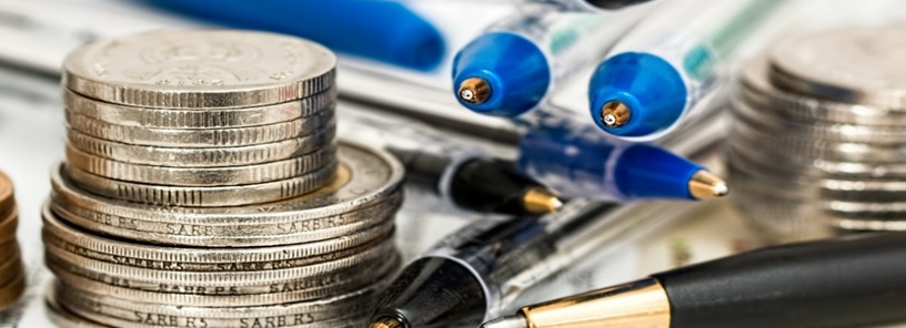 picture of pens and coins, working on saving money