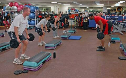 Photo of weightlifters in a gym