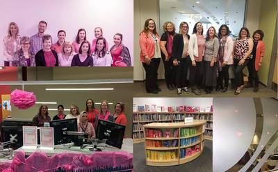 OPL employees dressed in pink at decorated service desks