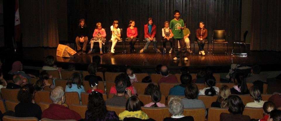 Youth telling stories on stage